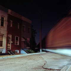 (patrickjoust) Tags: street city railroad urban usa house 120 6x6 tlr film home saint night analog america train dark square lens paul us moving reflex md focus long exposure crossing mechanical kodak united release tripod north patrick twin maryland cable row baltimore mat v 124g pro epson after medium format states manual 500 expired 80 joust yashica freight rowhouse rowhome estados 160 80mm f35 c41 unidos yashinon v500 ektacolor autaut patrickjoust