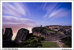 Heavenly Meteora (Ilan Shacham) Tags: longexposure sky cliff clouds landscape lights town rocks view scenic greece monastery le moonlight streaks meteora kalambaka agiatriada