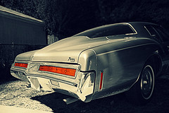 Luxury Fastback (Flint Foto Factory) Tags: auto city autumn light shadow red urban bw white chicago black color fall classic car night vintage evening illinois buick october automobile gm riviera shadows view nocturnal michigan hometown side rear north chrome american clark 70s marker 1970s andersonville flint luxury coupe 1973 edgewater taillights manufactured thorndale selective colorization fastback generalmotors 2door 2011 boattail threequarter worldcars personalluxury tailllamps
