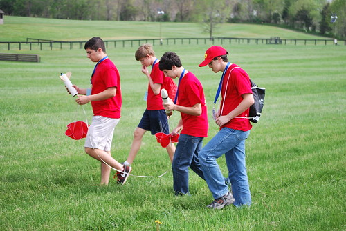 Boys team retrieving rocket