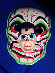 Green Grinning Skull Mask And Plastic Man 6302 (Brechtbug) Tags: green grinning skull mask halloween semi vintage with regular sized uncle sam box ben cooper collegeville halco ghoulsville retro newspaper sunday funnies comics holiday costume comic strip book comicbook spy movie film cinema americana america freedom justice super hero spooky jumbo size