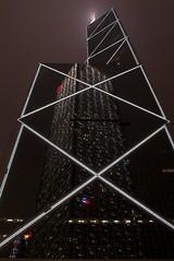 Skyscraper Reflects Skyscraper (kvijaynathan) Tags: city trip light urban reflection architecture night facade skyscraper hongkong finepixs2pro nikkor cheungkongcenter boctower 24mmf28ais