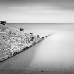 Groyne, Pembrokeshire (Weeman76) Tags: uk longexposure sea bw seascape monochrome wales mono nikon minimal le groyne minimalist amroth d90 pembokeshire nd110 niksoft silverefexpro2 sigma1770mmf284dcoshsm