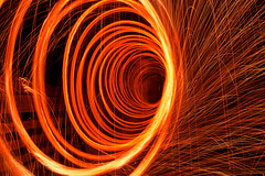 Vortex (charleswang55) Tags: seattle bridge light red orange white vortex motion black hot wool uw yellow night dark spiral fire washington nikon long exposure hole circles steel spin flame rings burn midnight poi 1855mm sparks tornado bounce d3100