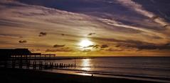 Parallel lines (Sundornvic) Tags: aberystwyth wales beach sea sky sun sunset clouds blue white glow pier jetty waves ripples rocks