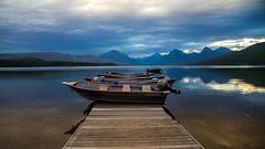 Moody afternoon (Elespics) Tags: glaciernationalpark usnationalparks lake lakemcdonald boats boatdock sunset nature water mountains