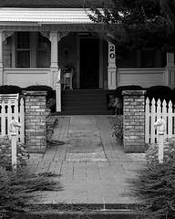 Bricked Walkway (Photographs By Wade) Tags: barnsdall oklahoma osagecounty walkway sidewalk bricked fence house