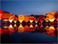 Balluminaria [ Explored ] (-=[Joms]=-) Tags: usa reflection nature water colors festival night balloons balluminaria cincinnati edenpark smiley hs10 hs11 fujifilmfinepixhs10 fujihs10 pnsers fujifilmfinepixhs11 fujihs11