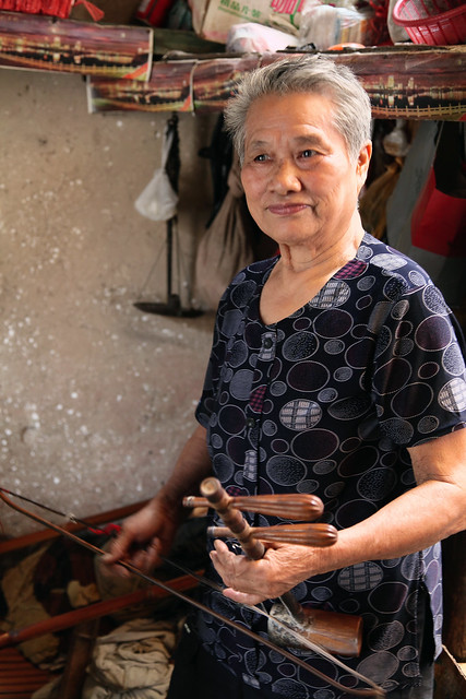 A woman playing the Erhu in Fuli, China