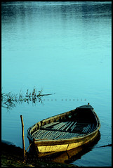 Lonely Boat - Won in an online photo competition @ Frame Bangladesh Group (Shahriar Xplores...) Tags: morning blue light water canon landscape eos boat interesting asia alone image explore local dhaka sell tori bangladesh recent gettyimages aisa 550d kiss4 canon550d requesttolicense framebangladesh shahriarphotography