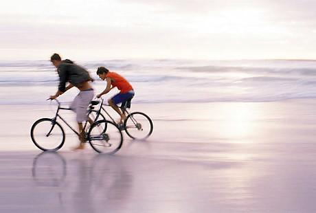Bicycling on the Beach | Landmark Holiday Beach Resort | Bluegreen