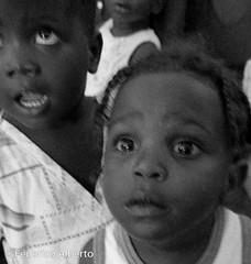Haunted (Federico Alberto) Tags: unicef portrait blackandwhite bw usaid blancoynegro children haiti eyes noiretblanc retrato grain olympus niños nb bn ojos pam blank despair enfants pma regards glazed grano ep1 wfp malnourishment miradas malnutrition portauprince m43 14mm desesperanza desnutrición nohdr eyeux puertopríncipe microfourthirds microcuatrotercios μ43 14140mm olympusep1 olympusdigitalpenep1 μfourthirds μcuatrotercios mcuatrotercios mfourthirds lumixg14140mm lumixgvario14140mm panasoniclumixg14140mmf458asph vidriosas