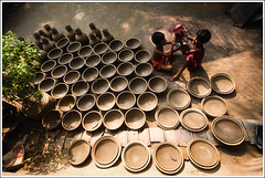 A Recurring Dream [..Chuadanga, Bangladesh..] (Catch the dream) Tags: girls light playing game children daylight doll pattern mud duo craft pots clay shade pottery household bangladesh repeat twogirls earthen lightandshade repetitive artandcraft repetation chuadanga earthenpots playingwithadoll alamdanga ailhash lightandpattern pottervillage craftsofbangladesh gettyimagesbangladeshq2