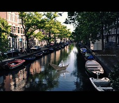 Floating down the canal (Violet Kashi) Tags: amsterdam reflections paper boat canal nikon explore frontpage d90