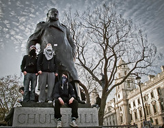 Churchill's Children (Sven Loach) Tags: uk england tree london students statue riot university december britain budget protest photojournalism demonstration masks cameron churchill government coalition winston cuts demonstrators 2010 reportage conservatives hoodies fees demos anarchists tuition tories g11 liberaldemocrats clegg londonist brokenbritain ananarchists