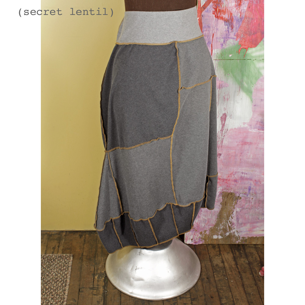 She's a stone - house. Architectural gold and gray skirt