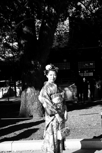 Girl in kimono under a tree