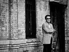 swingin' time traveler (zlandr) Tags: street city nyc newyorkcity urban blackandwhite bw newyork man men guy brooklyn blackwhite cool candid guys olympus smoking sp williamsburg smoker mafia mafioso unaware ep1 sportcoat chrisfarling zlandr bhphotoleicastreetphotographycontest