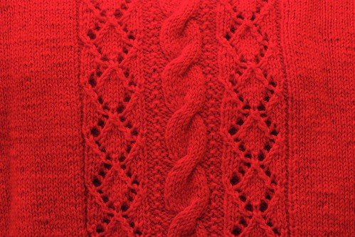 Back panel detail: red cardi