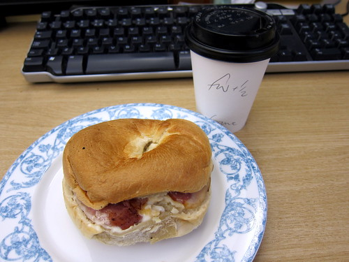Bacon and Egg Mayonnaise Bagel and a Flat White