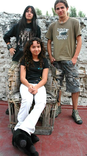 Cousins, China (seated with monster feet) and Alam (in Minor Threat t-shirt, standing) with close friend Jasshel, fashion, rooftop, Guadalajara, Jalisco, Mexico by Wonderlane