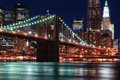 New York City (mudpig) Tags: nyc newyorkcity longexposure bridge newyork skyline brooklyn night geotagged cityscape dumbo gehry brooklynbridge eastriver gothamist woolworthbuilding mudpig stevekelley