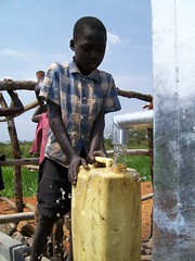 A boy fills his jerry can with clean water