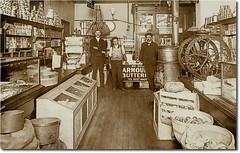 G. W. Wilson Fancy Groceries, Muncie, Indiana (Hoosier Recollections) Tags: people usa man men history coffee sepia advertising clothing workmen indiana shops grocery mills armour muncie businesses armandhammer nabisco delawarecounty realphoto hoosierrecollections elginnational