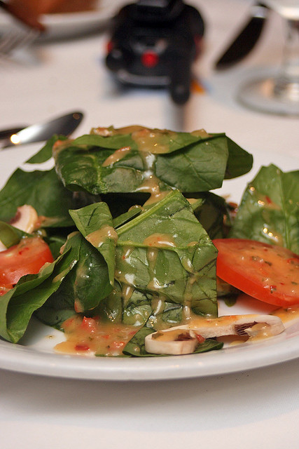 Spinach salad with plum tomatoes, sliced mushrooms and toasted sunflower seeds