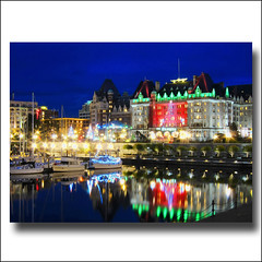 Victoria at Night . Christmas Day (ZedZap Photos) Tags: ocean christmas xmas blue winter sea snow reflection beach silhouette reflections boats bay harbor boat ship shadows silent bc harbour walk shoreline bleu vancouverisland shore boardwalk empress bluehour blau emilycarr victoriabc bcferries empresshotel parliamentbuilding fairmontempress beautifulbc zedzap
