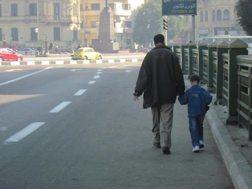 Father and Son Crossing Bridge