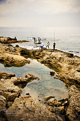 Their Favorite Pass-time... (SonOfJordan) Tags: sea sky people lebanon colour nature water rock clouds canon eos fishing beirut xsi 450d sonofjordan shadisamawi wwwshadisamawicom
