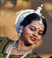 The Dancing Beauty (Rimi's Magik!) Tags: winter portrait india nature beauty festival lady dance nikon dof dancing expression culture chennai orissa odissi indiandance incrediblendia dakshinachitra d90 indianculture tamilnadutourismtravel
