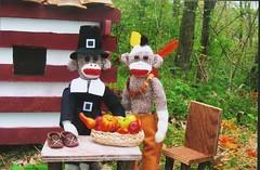 Sock Monkey Thanksgiving (monkeymoments) Tags: thanksgiving woods feathers logcabin sockmonkeys monkeys indians pilgrim cornucopia headdress moccasins monkeyfun sockmonkeyhumor