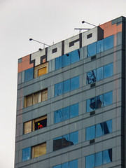 To Go (Steve Taylor (Photography)) Tags: togo art tag building window office blue black brown yellow white orange glass wood newzealand damage earthquake demolition quake smashed broken 22february2011 workman man nz southisland canterbury christchurch cbd city crane reflection