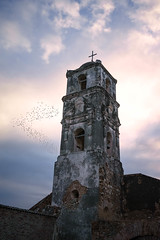 Trinidad Church Aviary (kevinwenning) Tags: wenning trinidad church kevinwenning tower intentionallylostcom old cuba birds sky cross steeple weather clouds crumbling