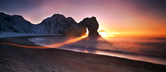 Durdle Door Sunrise 2 (peterspencer49) Tags: durdle door durdledoor rockarch limestone arch limestonearch worldheritagesite unesco england uk jurassiccoast coast seaview oceanview seascape sunrise southwest westcountry peterspencer worldheitagesite winterview winter unitedkingdom southwestcoastalpath southwestcoast seamist lulworthcove coastalpath clouds cliffwalks archway dorsetcoast dorset peterspencer49 5dmkll