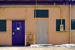 Indy#5734_Copy (Single-Tooth Productions) Tags: city winter urban orange snow building green ice colors lines architecture composition 50mm nikon doors purple architecturaldetail squares indianapolis buildingdetail shapes entrance salmon violet indiana gutter nikkor utilities entry conduit standpipe doorways rectangles bollards electricmeter entryways boardup gasmeter concreteblock boardedupwindows purpledoor nikond200 neside nikkor50mmf18daf icesickles colorcomposition graydoor paintedconcreteblock buildingexteriorwall violetdoor paintedexteriorbuildingwall
