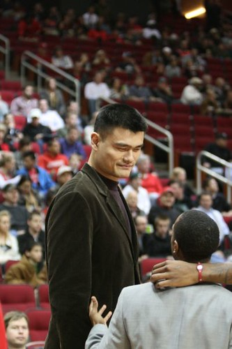 December 27th, 2010 - Yao Ming talks with Houston Rocket guard Ish Smith before the Rockets-Wizards game