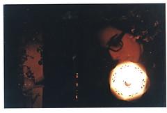 Flowers In Your Hair (Double Exposure) (Tara-Leigh) Tags: light portrait orange selfportrait black lamp girl yellow hair glasses lomo lomography doubleexposure profile grain dianamini