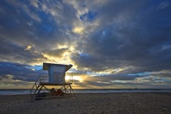 no lifeguard on duty (Eric 5D Mark III) Tags: california light sunset sky usa cloud seascape color tower beach canon landscape twilight unitedstates empty perspective lifeguard lonely rays orangecounty huntingtonbeach tone emptiness sunbursts ef1635mmf28liiusm eos5dmarkii