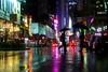 Near Times Square After the Rain (Airicsson) Tags: street new york city nyc summer urban usa ny reflection rain umbrella island lumix us walk manhattan panasonic rainy timessquare 2010 streetshot lx3