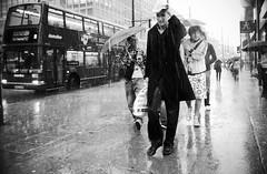 Feeling Good (Ian Brumpton) Tags: street blackandwhite bw blancoynegro blackwhite noiretblanc pavement candid citylife londres happynewyear stormyweather parapluie walkingwithpurpose raintown feelinggood ilpleut sidewalkstories londonstreetphotography lifeinslowmotion scattidistrada blitzunddonner neroameta aspotofrain ianbrumpton aimlessstrolling londonatlarge