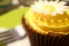 {The cute little cupcake} ({ImagesByKarin}) Tags: light food brown inspiration flower cup colors yellow cake wow baking amazing lemon focus colorful pretty flavor yum desert zoom drink sweet chocolate tissue plate fork cupcake bakery smell daisy icing yellowcupcake