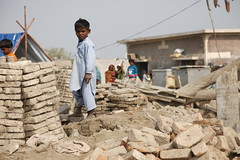 A child stands amongst the remains of buildings destroyed by the floods in Sindh province, Pakistan.