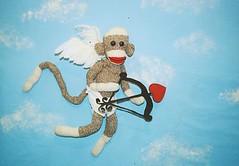 Sock Monkey Love is in the air (monkeymoments) Tags: sky love angel clouds sockmonkeys monkeys cupid valentinesday bowandarrow humorouslove