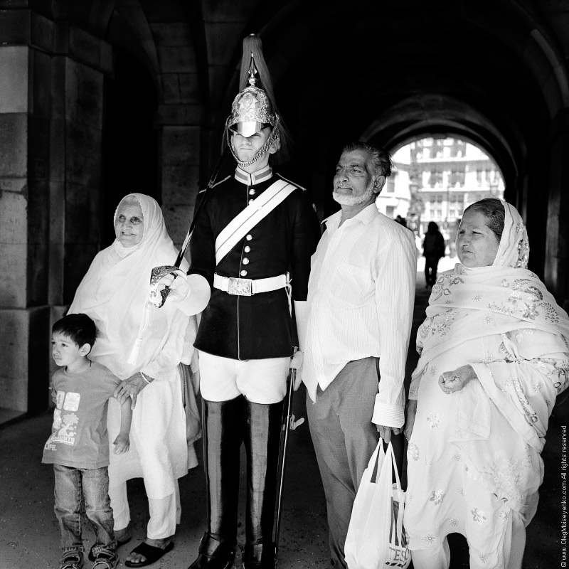 Muslim family posing for picture with Queen's Guard, London