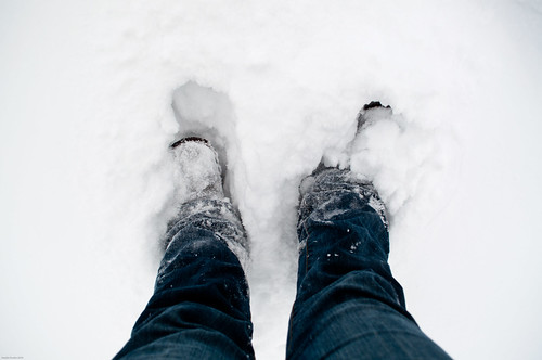 view of my legs from above with me standing in the snow, snow is covering my feet up to my ankles