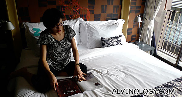 Rachel reading a magazine on the bed