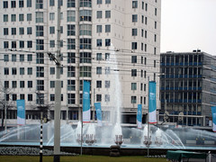 Water, up, up! Higher and higher (Clara Ungaretti) Tags: blue windows holland building green geometric water fountain up grass lines architecture rotterdam europa europe down center flags cables holanda nl higher citycenter pasesbaixos
